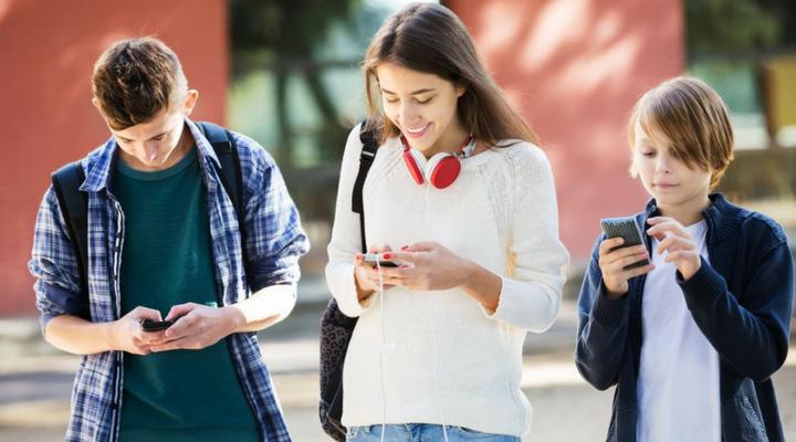 teenagers using their phones