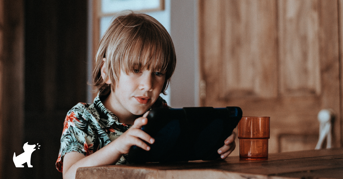 A photo of a child looking at a tablet screen