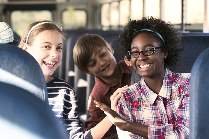 teenagers laughing on the bus