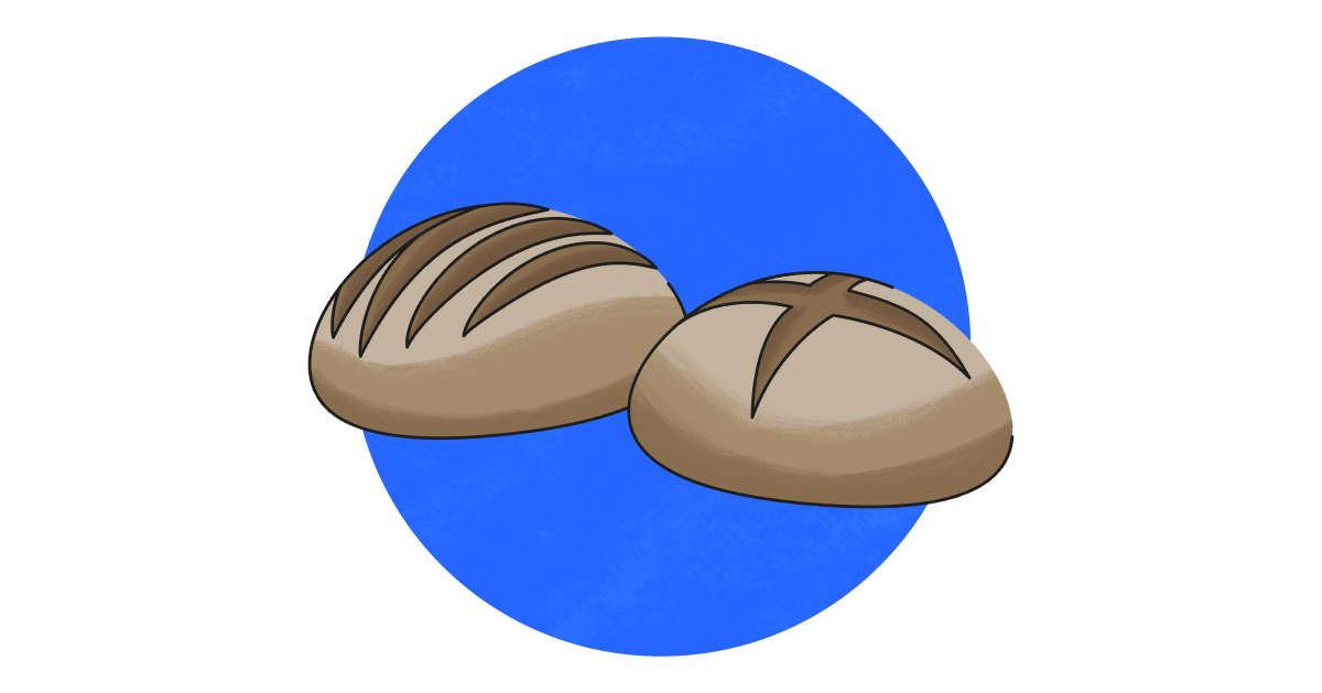 Two bread loaves against a blue background