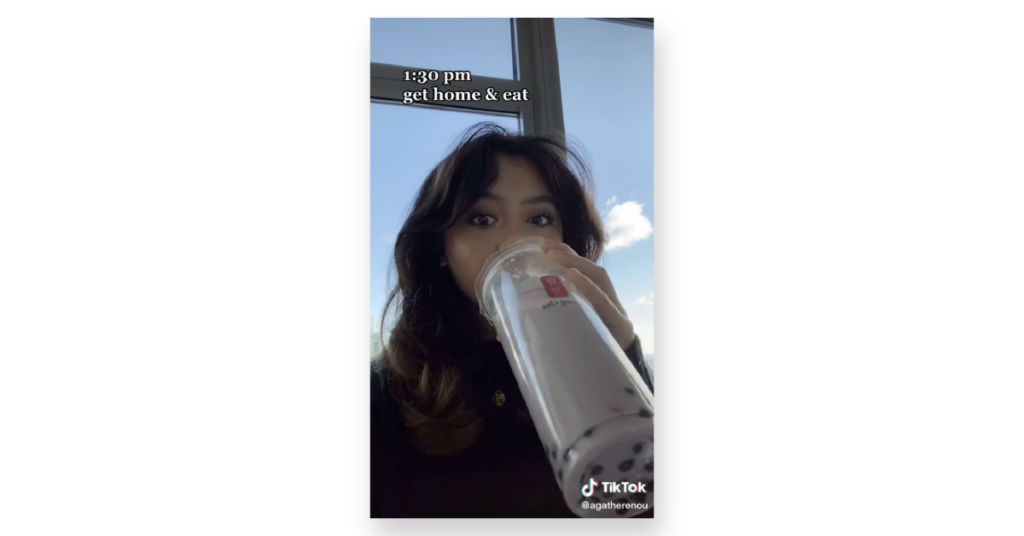 Woman drinking from large cup