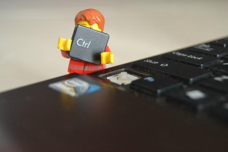 lego man taking key off keyboard