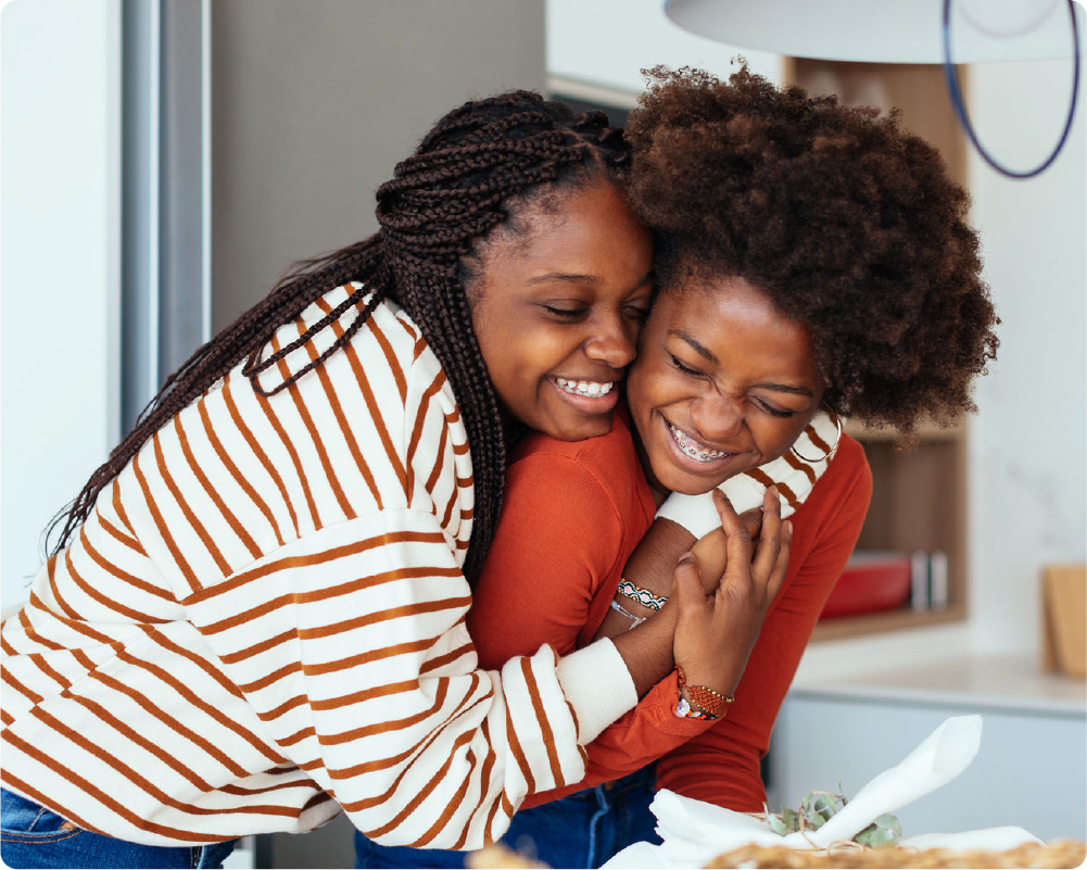 Best parental control app Android shown by a parent and child embracing